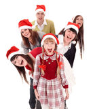 Gelukkig groepsmensen en kind in santahoed. Stock Fotografie
