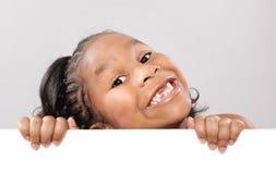 Gelukkig jong geitje met exemplaarruimte Stock Foto