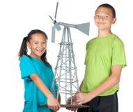 Gelukkig jongen en meisje met windmolen Stock Fotografie