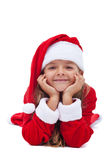 Gelukkig Kerstmismeisje die haar hoofd propping Stock Afbeeldingen