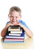 Gelukkig kind met boeken stock foto's