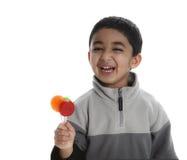 Gelukkig Kind met Drie Kleurrijke Lollys Royalty-vrije Stock Foto's