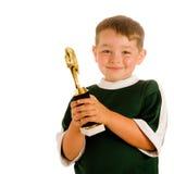 Gelukkig kind in voetbaltrofee royalty-vrije stock afbeeldingen