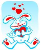 Gelukkig konijn met hart Stock Foto