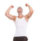 Gelukkig mannelijk atleten verheugend succes Stock Foto's