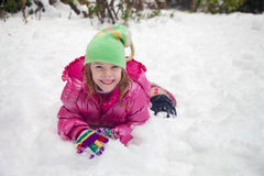 Gelukkig meisje in de sneeuw Royalty-vrije Stock Fotografie