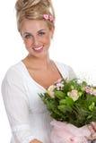 Gelukkig meisje met bloemen Stock Afbeelding