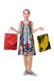 Gelukkig meisje met document zakken voor het winkelen. Stock Foto's