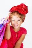 Gelukkig meisje met het winkelen zakken royalty-vrije stock afbeelding