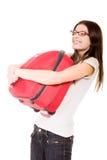 Gelukkig meisje met koffer op een witte achtergrond stock afbeeldingen