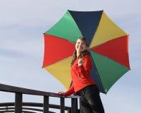 Gelukkig meisje met paraplu Stock Foto