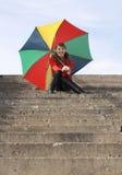 Gelukkig meisje met paraplu Stock Afbeeldingen