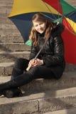 Gelukkig meisje met paraplu Stock Fotografie