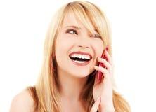 Gelukkig meisje met roze telefoon stock foto