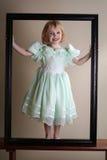 Gelukkig meisje in omlijsting Royalty-vrije Stock Fotografie