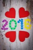 Gelukkig nieuw jaar 2016 gemaakt van kleurrijke harten en rode houten harten Royalty-vrije Stock Afbeelding