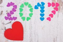 Gelukkig nieuw jaar 2017 gemaakt van kleurrijke harten, exemplaarruimte voor tekst Stock Fotografie