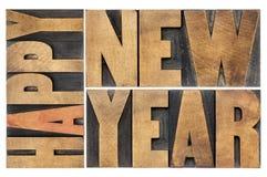 Gelukkig nieuw jaar in houten type Stock Afbeeldingen