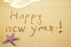Gelukkig nieuw jaar op zand Stock Afbeelding