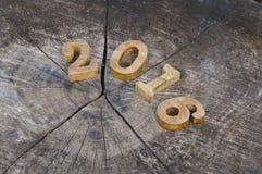 Gelukkig Nieuwjaar 2016, aardconcept en houten aantalidee Stock Afbeeldingen