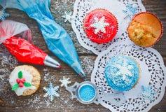 Gelukkig Nieuwjaar en Vrolijke Kerstmisachtergrond - Kerstmis cupcak Stock Foto