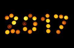 Gelukkig Nieuwjaar - 2016 gemaakt met kaarsen op zwarte Stock Foto's