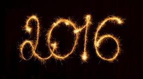 Gelukkig Nieuwjaar - 2016 met sterretjes op zwarte Royalty-vrije Stock Foto's