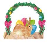 Gelukkig Pasen-decor - een leuk bruin konijn met gekleurde eieren onder het kader van rieten de lentetakjes Hand getrokken waterv stock illustratie