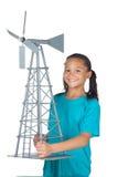 Gelukkig schoolmeisje met windmolen Stock Foto's