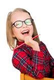 Gelukkig schoolmeisje in oogglazen met een potlood Royalty-vrije Stock Foto's
