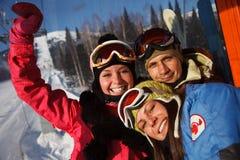 Gelukkig snowboarding team royalty-vrije stock fotografie