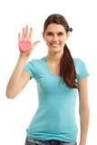 Gelukkig tienermeisje dat in hand hart houdt Stock Fotografie