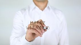 Gelukkig Weekend, Zakenman Writing op Glas stock fotografie