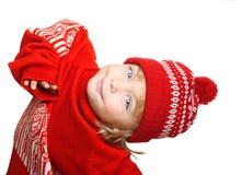 Gelukkig weinig jongen in rode hoed en sweater Stock Foto's