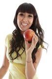 Gelukkig wijfje dat gezonde appel eet royalty-vrije stock foto