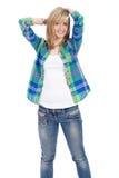 Gelukkige aantrekkelijke blonde vrouwelijke spruit over wit Stock Fotografie