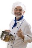 Gelukkige aantrekkelijke kok stock foto's