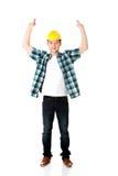 Gelukkige arbeider die lege banner voorstellen Stock Afbeeldingen