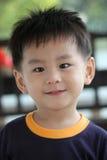 Gelukkige Aziatische jongen stock afbeelding