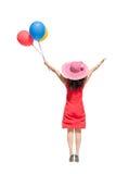 Gelukkige Aziatische vrouw die en ballons springen houden Royalty-vrije Stock Foto's