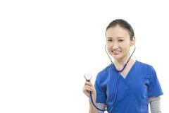 Gelukkige Aziatische vrouwelijke gezondheidszorgarbeider Stock Foto's