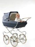 Gelukkige baby in de wandelwagen Stock Foto's