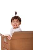 Gelukkige baby in het bewegen van doos Royalty-vrije Stock Fotografie