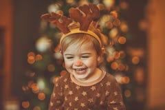 Gelukkige baby het vieren Kerstmis stock fotografie