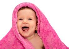 Gelukkige baby met rode handdoek Stock Foto