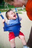 Gelukkige baby in speelplaats Royalty-vrije Stock Foto's