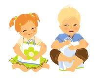 Gelukkige baby twee met een giftzak in handen Royalty-vrije Stock Foto's