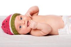 Gelukkige babyzuigeling met hoed Stock Fotografie