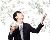 Gelukkige bedrijfsmens met ons geld Royalty-vrije Stock Afbeelding