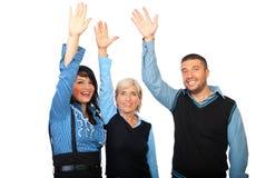 Gelukkige bedrijfsmensen met omhoog handen Stock Fotografie